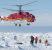 "This photo released by the Australian Antarctic Division on January 2, 2014 shows a rescue helicopter from the Chinese ship Xue Long carrying passengers who spent Christmas and New Year trapped on the icebound Russian research vessel Akademik Shokalskiy in Antarctica shortly prior to landing after they were airlifted from the ice in a dramatic rescue mission, as rescue workers gather near a makeshift landing pad. The Chinese helicopter which landed on a makeshift landing pad next to the marooned ship ferried the scientists, tourists and journalists in groups of 12 to an Australian government supply ship, the Aurora Australis.  TOPSHOTS    AFP PHOTO / Jessica Fitzpatrick / Australian Antarctic Division ---EDITORS NOTE--- RESTRICTED TO EDITORIAL USE - MANDATORY CREDIT ""AFP PHOTO / Jessica Fitzpatrick / Australian Antarctic Division"" - NO MARKETING NO ADVERTISING CAMPAIGNS - DISTRIBUTED AS A SERVICE TO CLIENTS  -- NO ARCHIVES  -- ONE TIME USE -- NO SALES"